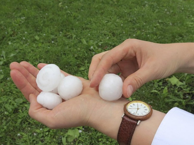 Large hailstone after storm in hand